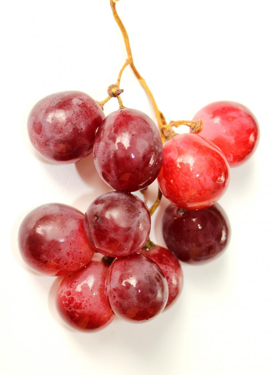 Download Free Stock HD Photo of Bunch of red globe grapes on white Online