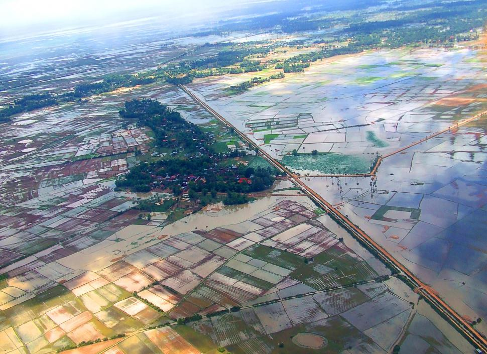 Download Free Stock HD Photo of Aerial view from a balloon of flooded rice fields in Siem Reap c Online