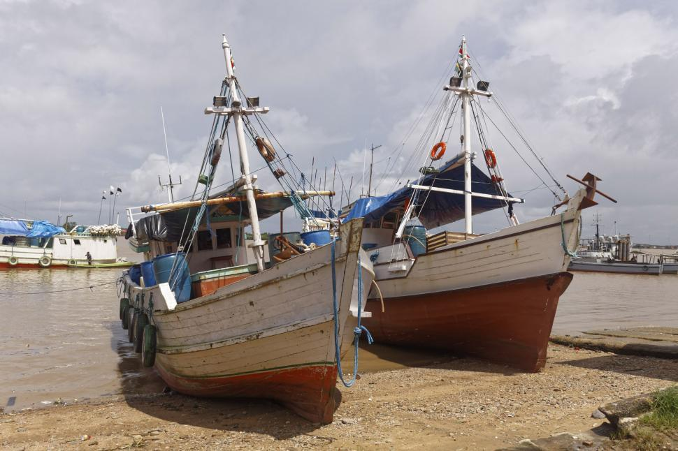 Download Free Stock HD Photo of Two Fishing Boats at Low Tide Online