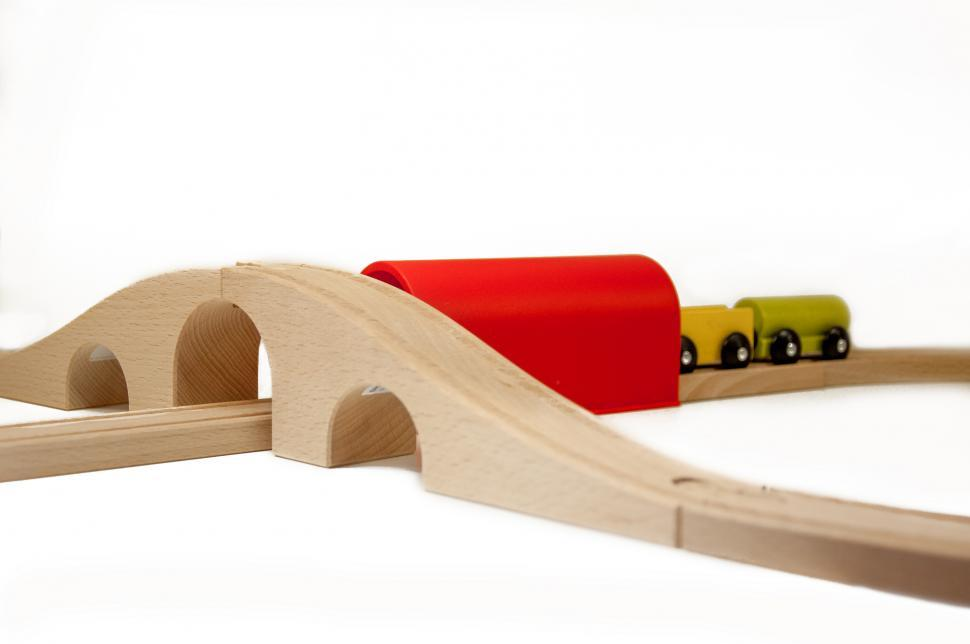 Download Free Stock HD Photo of Wooden toy train on railroad Online
