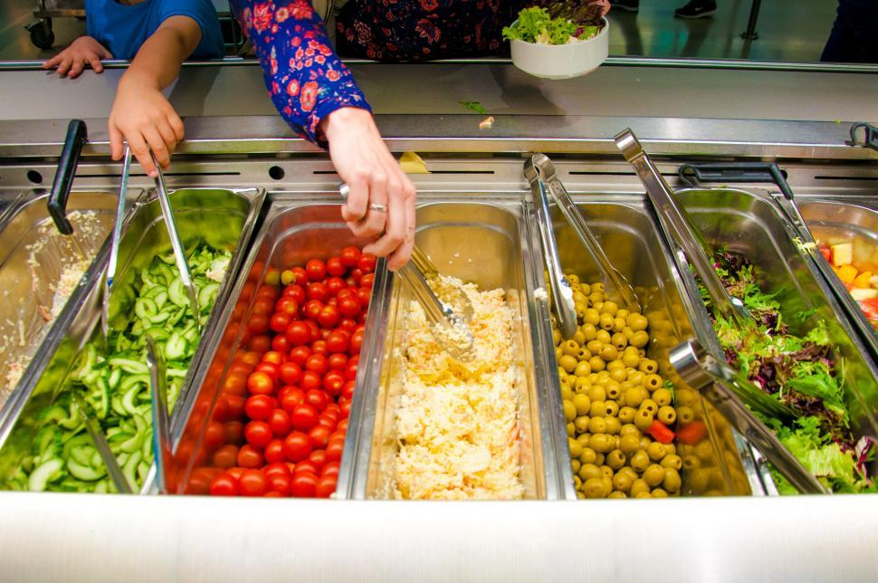 Download Free Stock HD Photo of salad bar with vegetables in the restaurant Online
