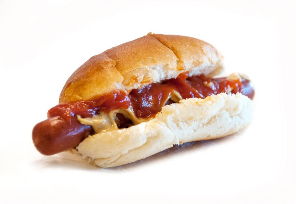 Download Free Stock HD Photo of Hot Dog with mustard and ketchup isolated Online