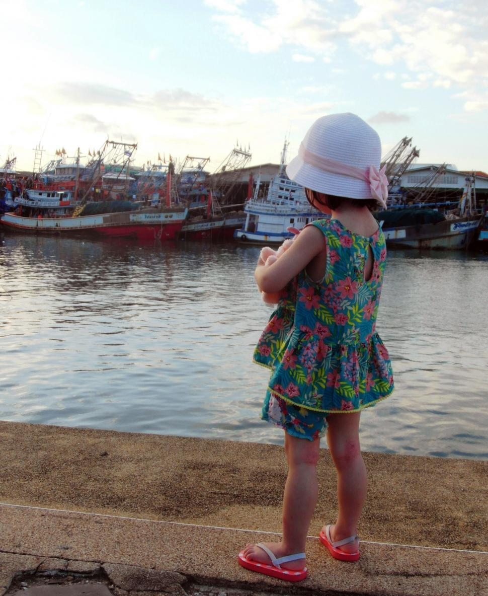 Download Free Stock HD Photo of Girl Looking at Fishing Boats Online