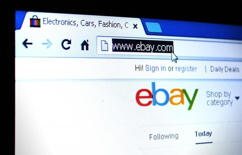 eBay webpage on the screen - shopping and bidding. Editorial use