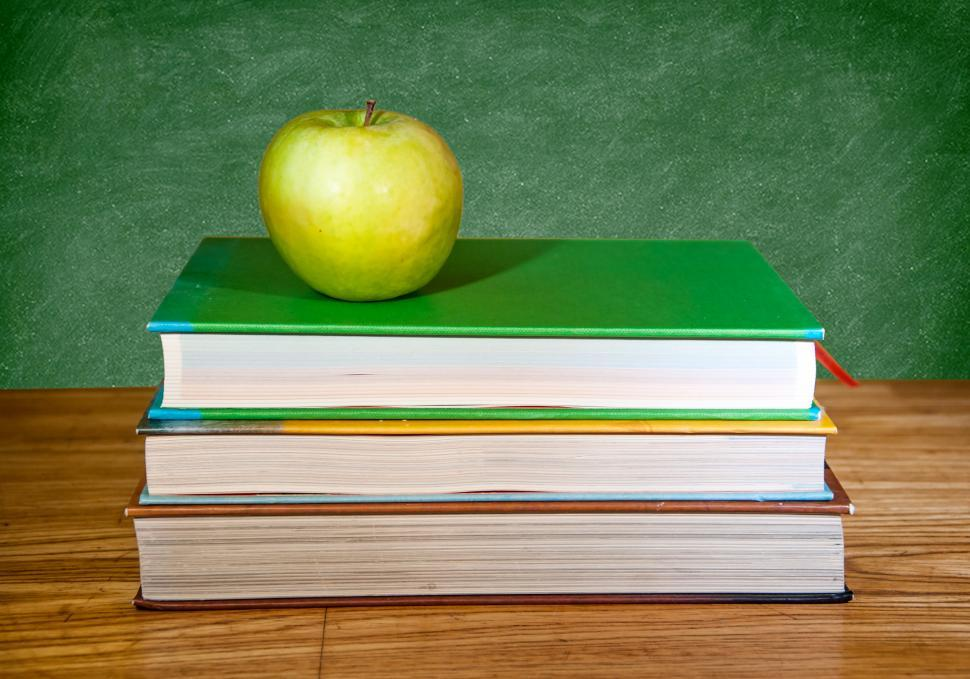 Download Free Stock HD Photo of back to school books, apple and chalkboard Online