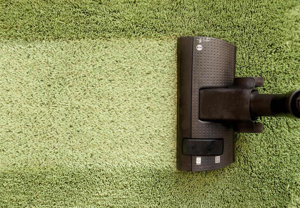 Vacuum Cleaner On Carpet Cleaning