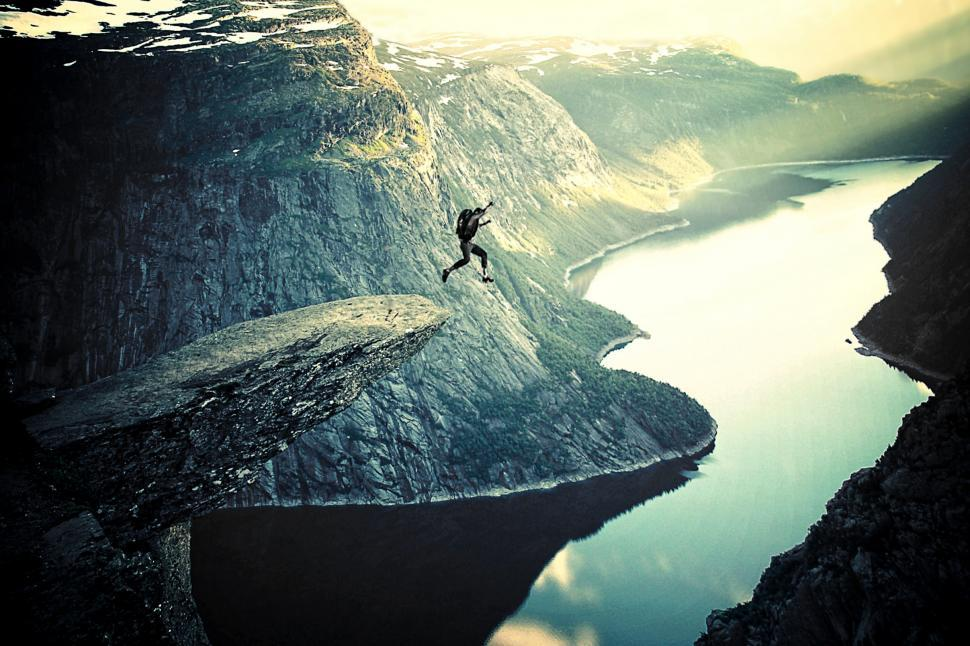 Download Free Stock HD Photo of Into Thin Air - BASE Jumping off Trolltunga - Extreme Sports in Norway Online