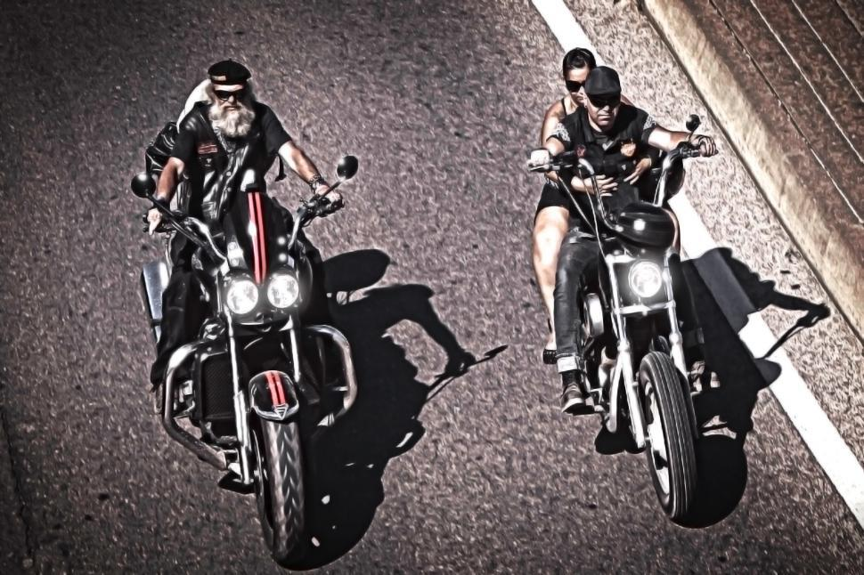 Download Free Stock HD Photo of Two generations of bikers riding choppers Online