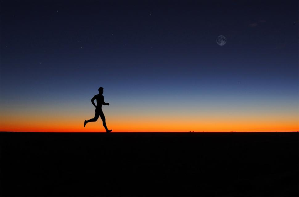 imageDesc for cat Man running alone at dawn page Sports & Recreation