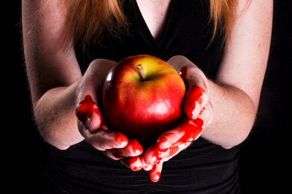 Download Free Stock HD Photo of Bloody hands holding apple Online