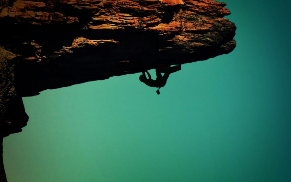 Download Free Stock HD Photo of Silhouette of a rock-climber Online