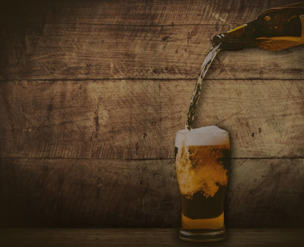 Download Free Stock HD Photo of Pouring beer - washed out vintage looks with copyspace Online