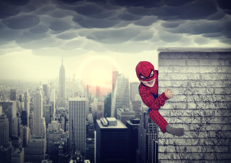 Download Free Stock HD Photo of Young boy dreams of being a superhero - Child imagination and cre Online