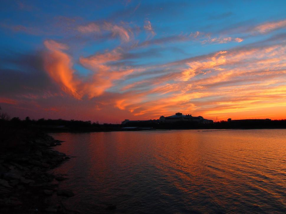 Download Free Stock HD Photo of Beautiful sunset over water Online