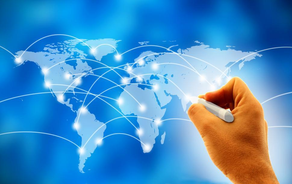 Free image of Business man drawing social network or business connections on world map on a virtual screen board
