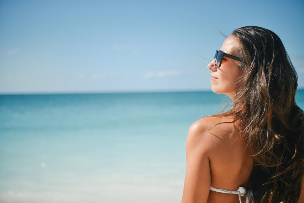 Download Free Stock HD Photo of Woman in sunglasses at the beach Online