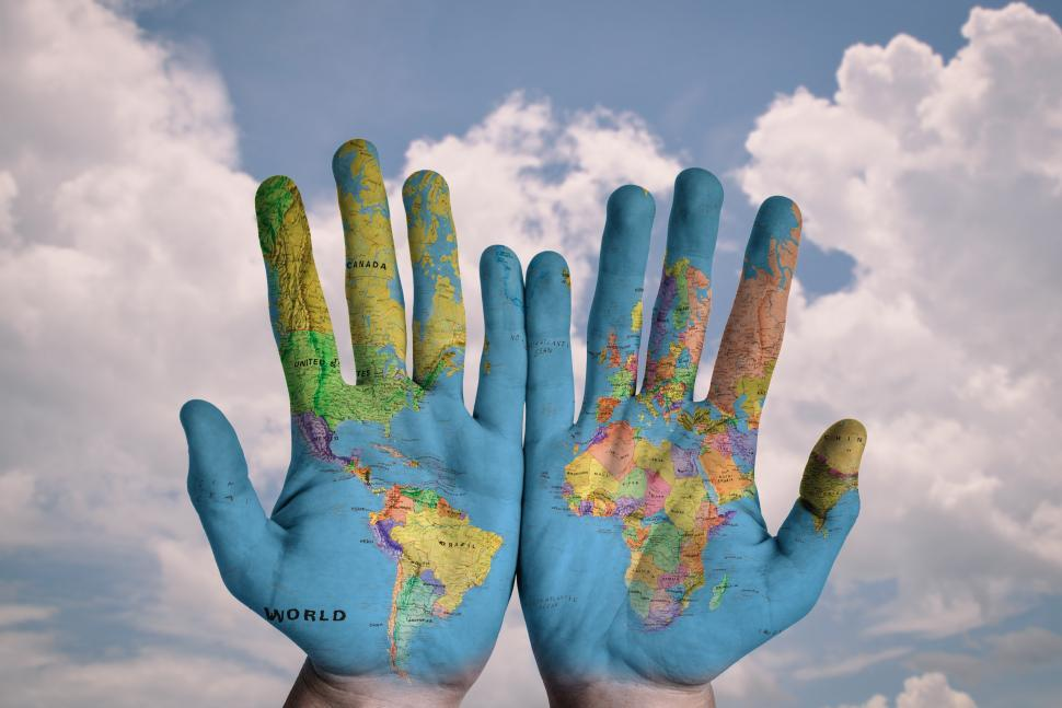 Get free stock photos of world map on hands online download latest download free stock hd photo of world map on hands online gumiabroncs Gallery