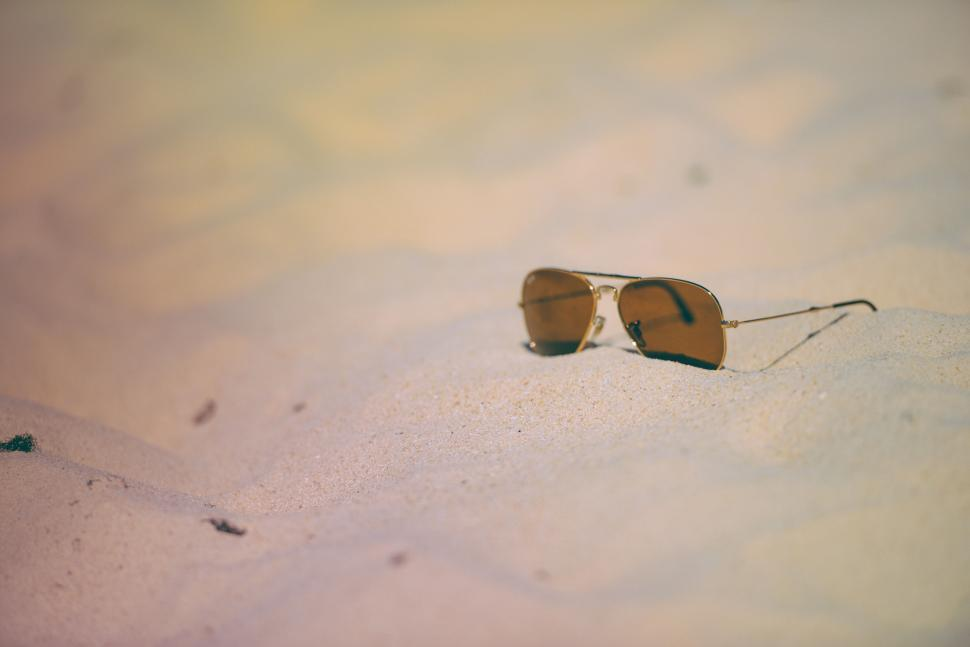 Download Free Stock HD Photo of Sunglasses on the beach Online
