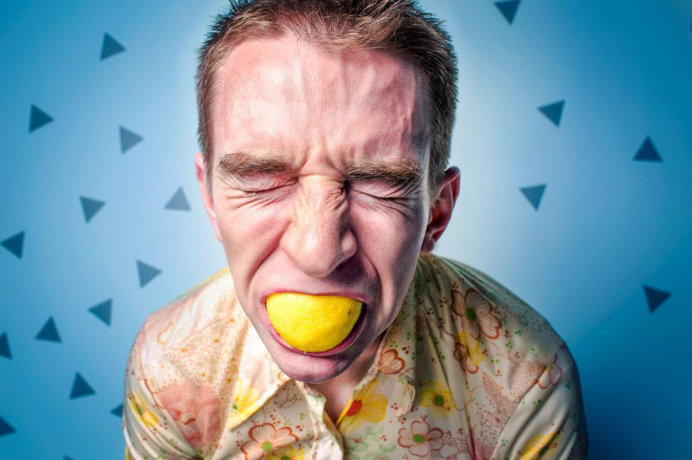 Download Free Stock HD Photo of Man With Lemon In Mouth Online