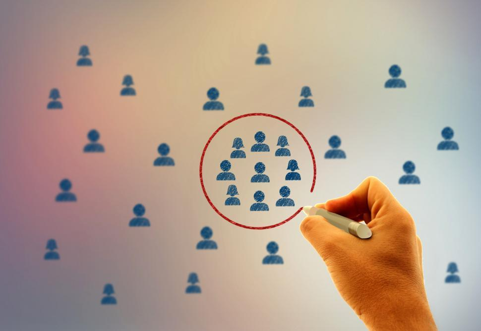 Free image of Businessman drawing a circle around people icons - Marketing and consumer target groups concept