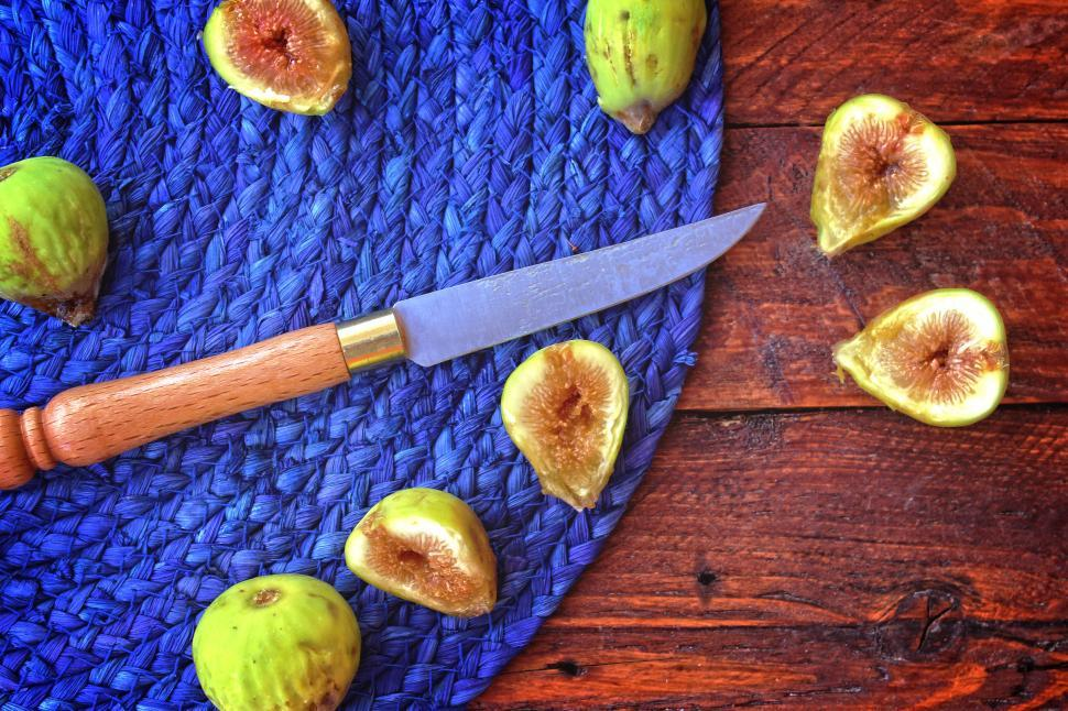 Download Free Stock HD Photo of Summer s end - The last wild figs of the season sliced on the ta Online