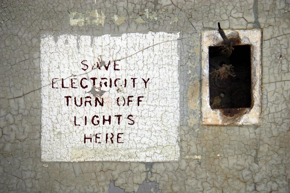 Download Free Stock HD Photo of Destroyed electrical outlet and sign Online