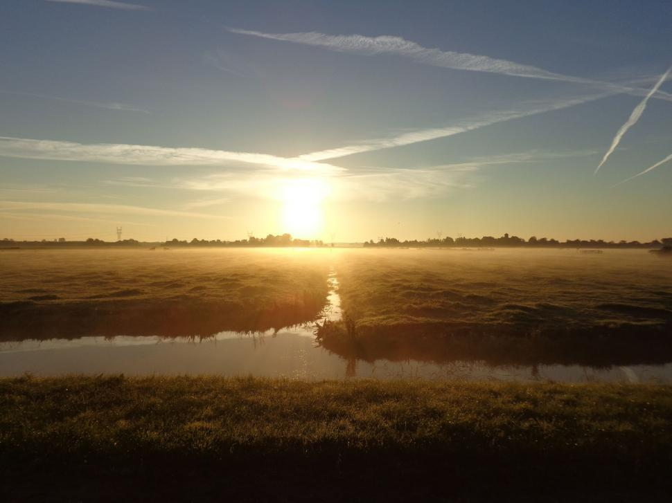 Download Free Stock HD Photo of Sunrise in the Netherlands over fields Online