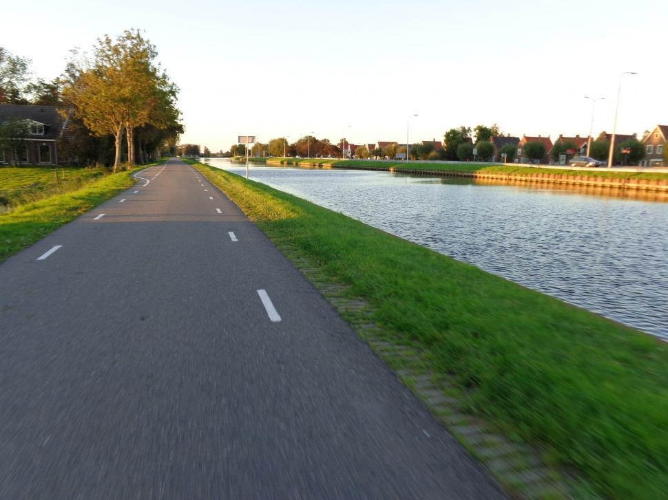 Download Free Stock HD Photo of Cycling on path in the Netherlands  Online