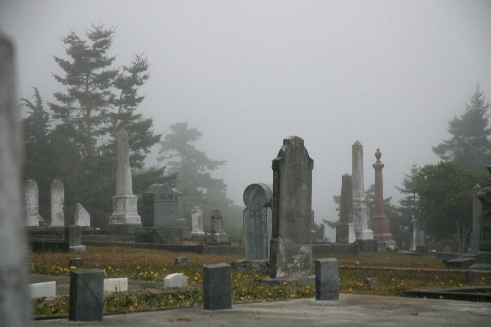 Free image of Eerie fog around graves in a cemetary