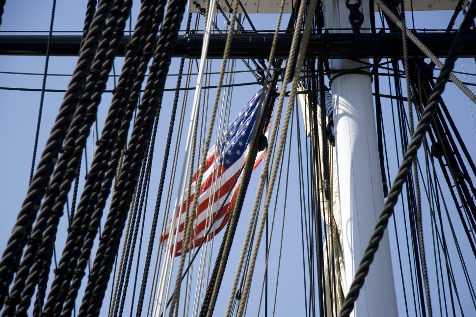 Download Free Stock HD Photo of American Flag flies over the USS Constitution Online