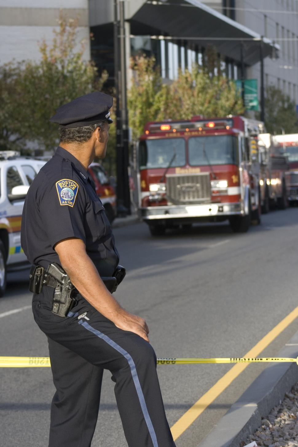 Download Free Stock HD Photo of Policeman and Firetruck Online