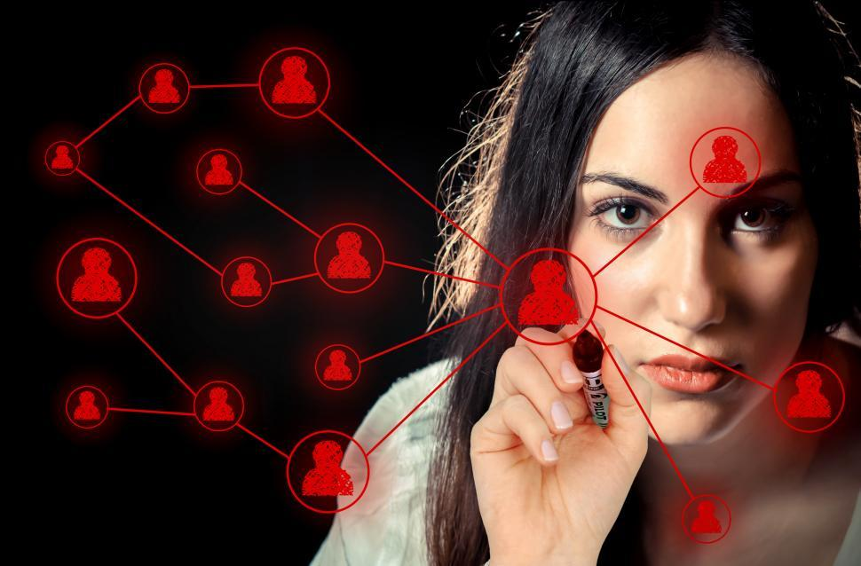 Download Free Stock HD Photo of Woman sketching a social network on virtual screen Online