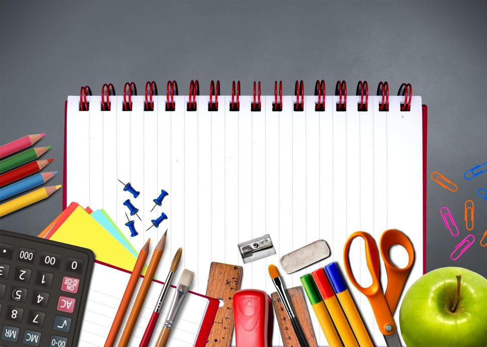 Download Free Stock HD Photo of School supplies on notebook - Study and learning concept Online