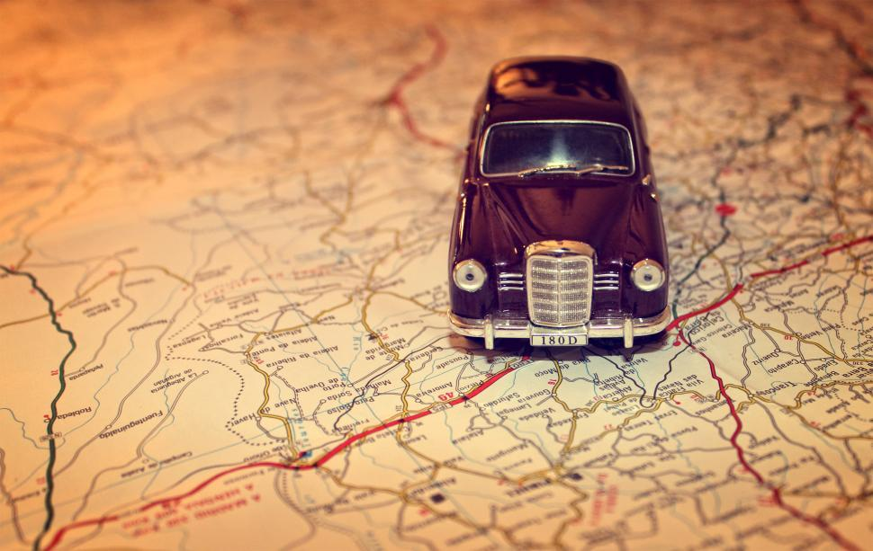 Download Free Stock HD Photo of Hit the road - Travel concept with vintage miniature car on road Online