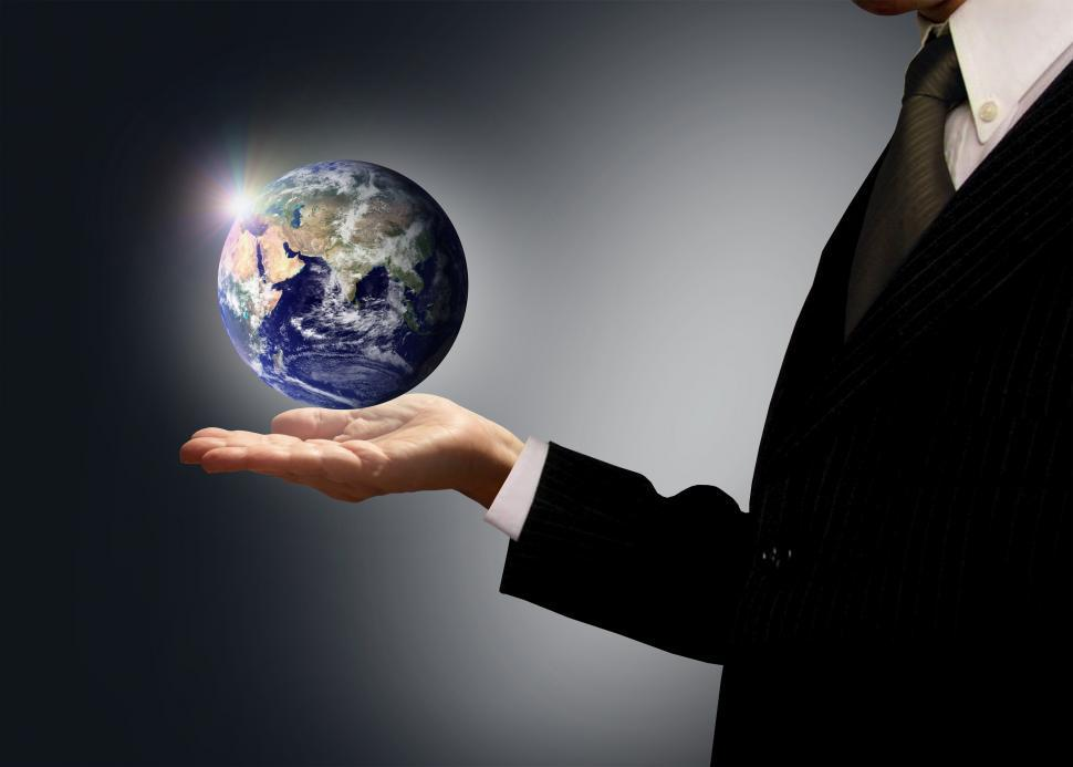 Download Free Stock HD Photo of Businessman holding Earth globe - Globalization concept Online