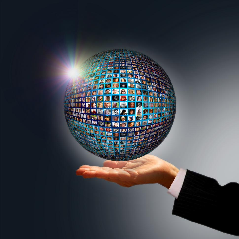 Businessman holding a globe made of people - Social media networ