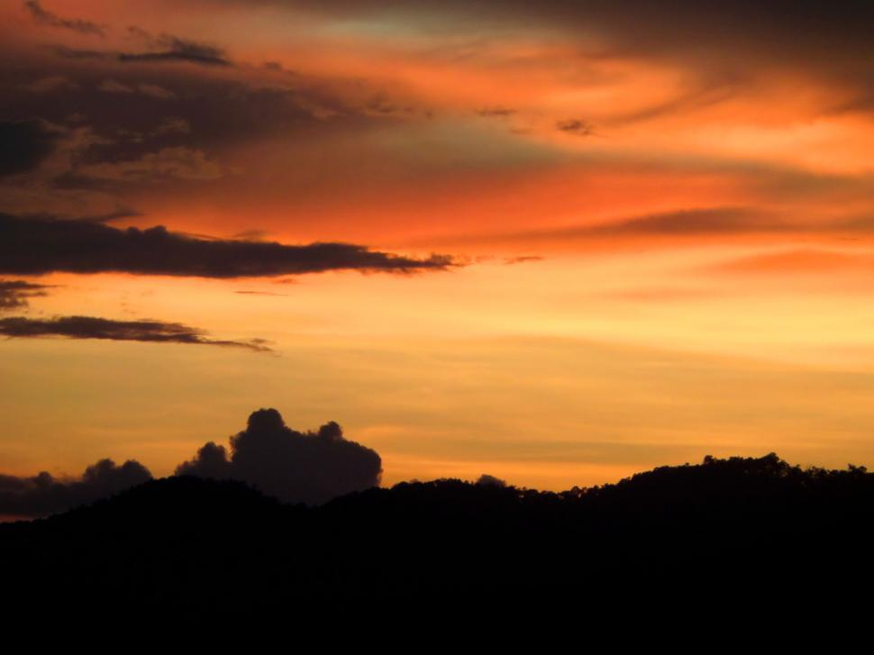 Download Free Stock HD Photo of sunset sky over silhouetted hills  Online
