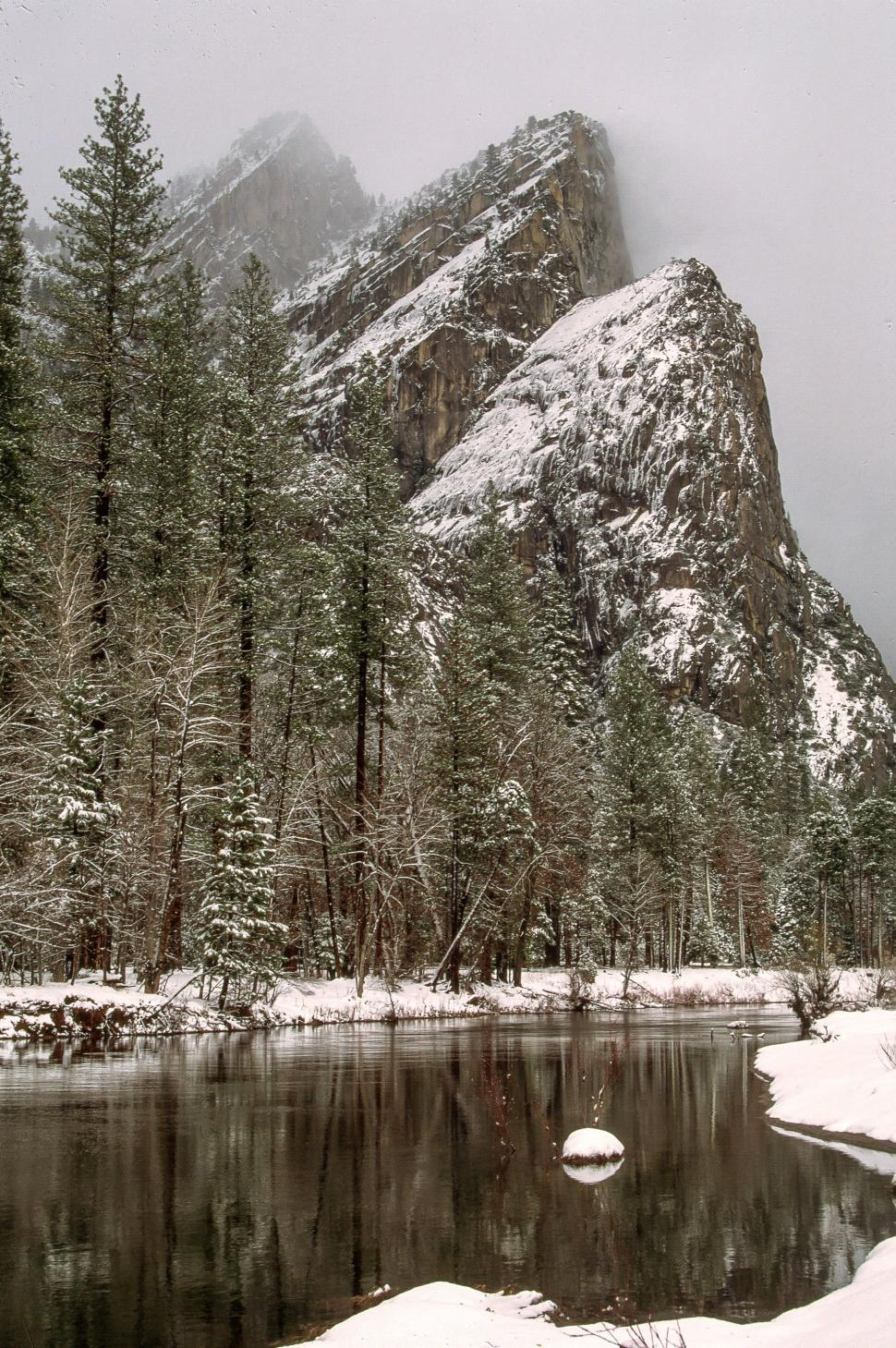 Download Free Stock HD Photo of Three Brothers Peak in Yosemite Valley Online