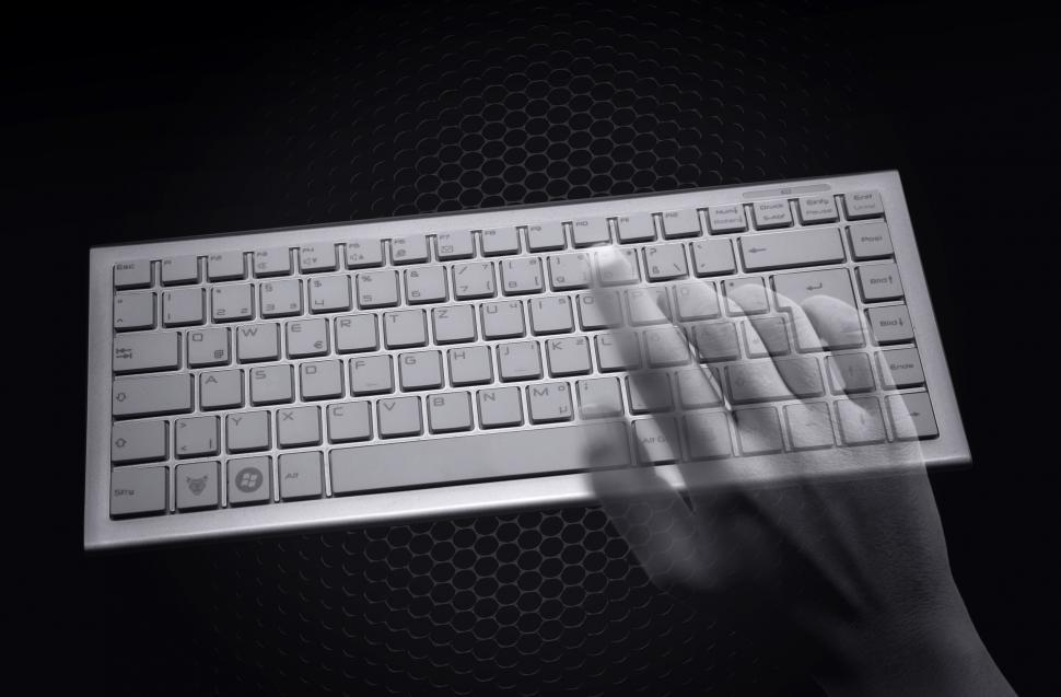 Download Free Stock HD Photo of Hacking concept - Transparent hands over computer keyboard Online
