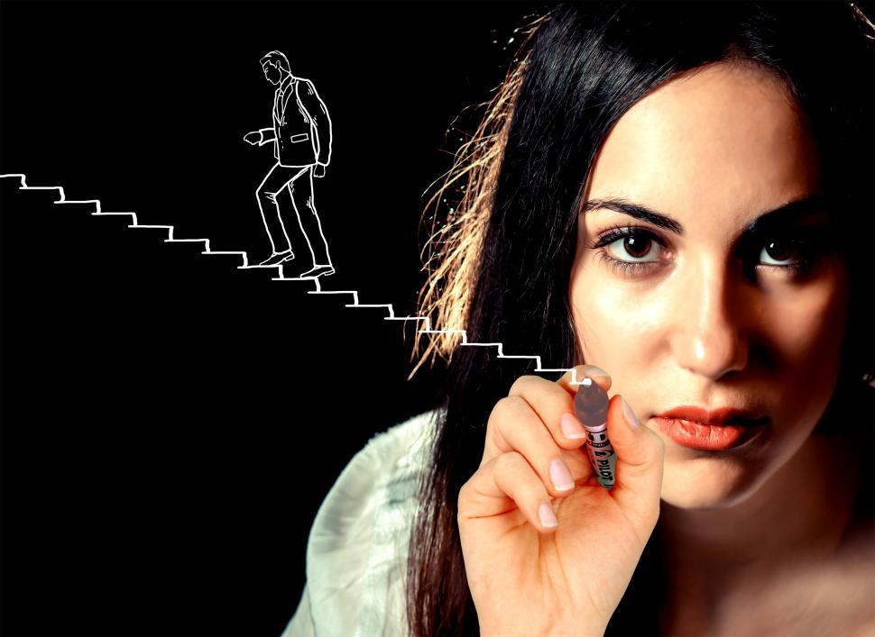 Download Free Stock HD Photo of Woman sketching a businessman climbing stairs - Career and succe Online