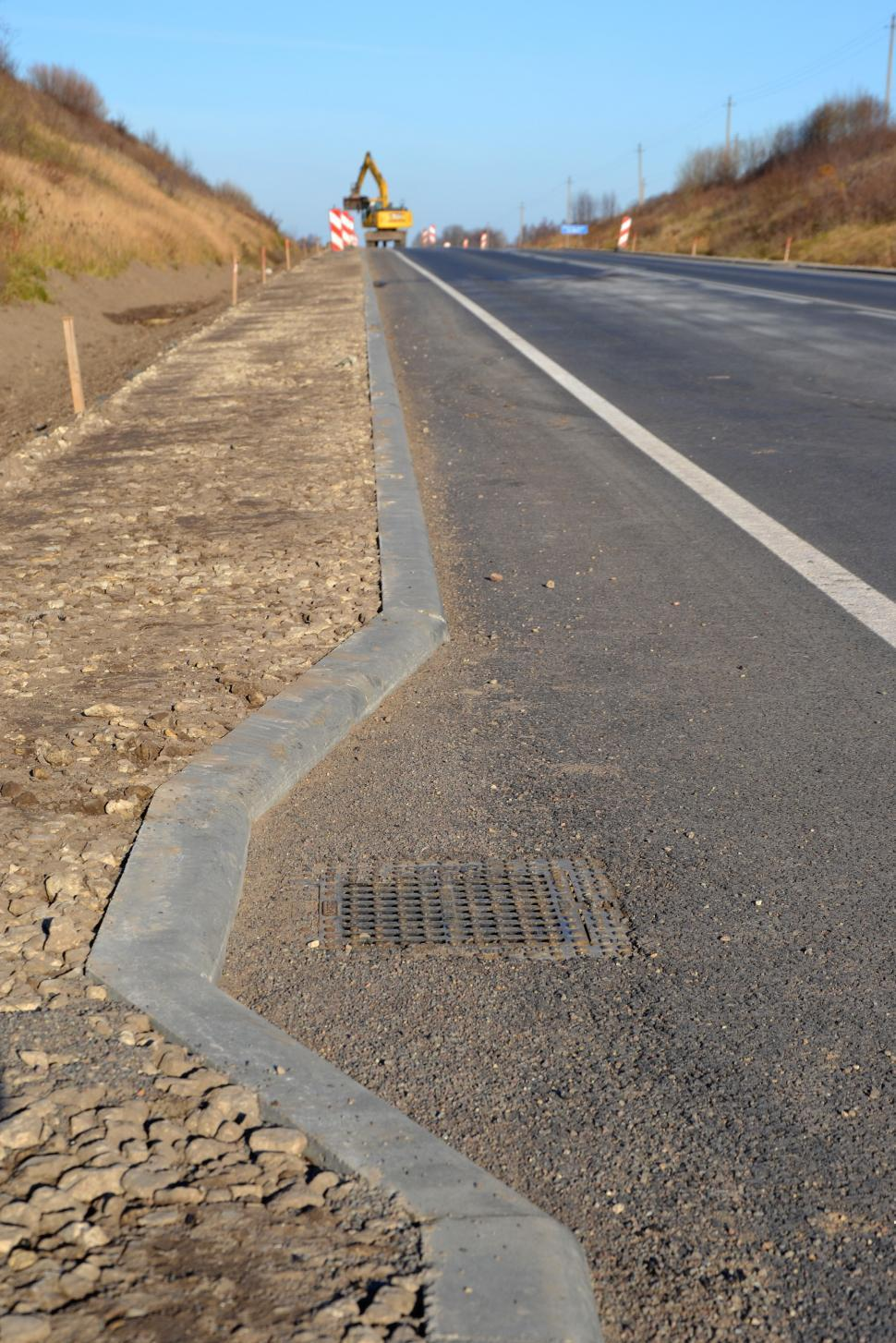 Download Free Stock HD Photo of Road drainage and curb Online
