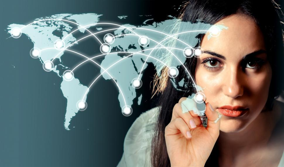 Download Free Stock HD Photo of Woman drawing a network over a virtual world map Online