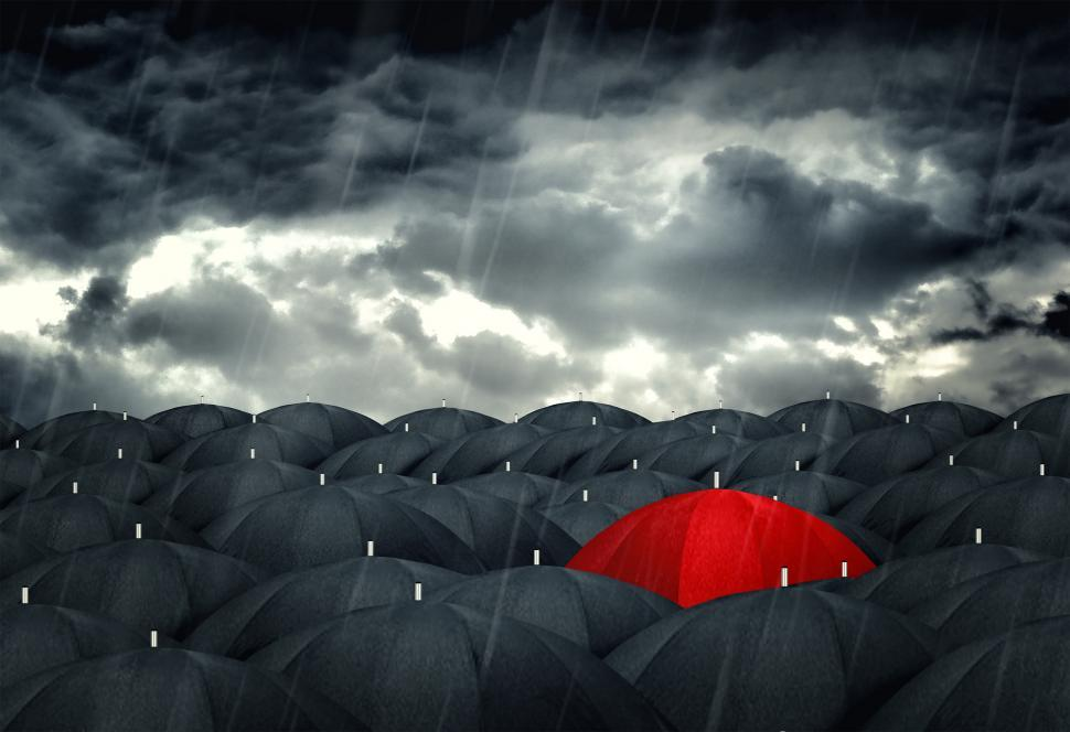 Free image of Red umbrella mingling with grey umbrellas - Be different concept