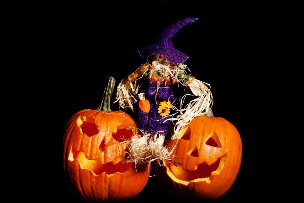 Download Free Stock HD Photo of Scarecrow sitting on  Pumpkins Online