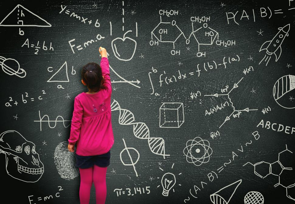 Download Free Stock HD Photo of Little girl writing on blackboard - Learning and knowledge conce Online