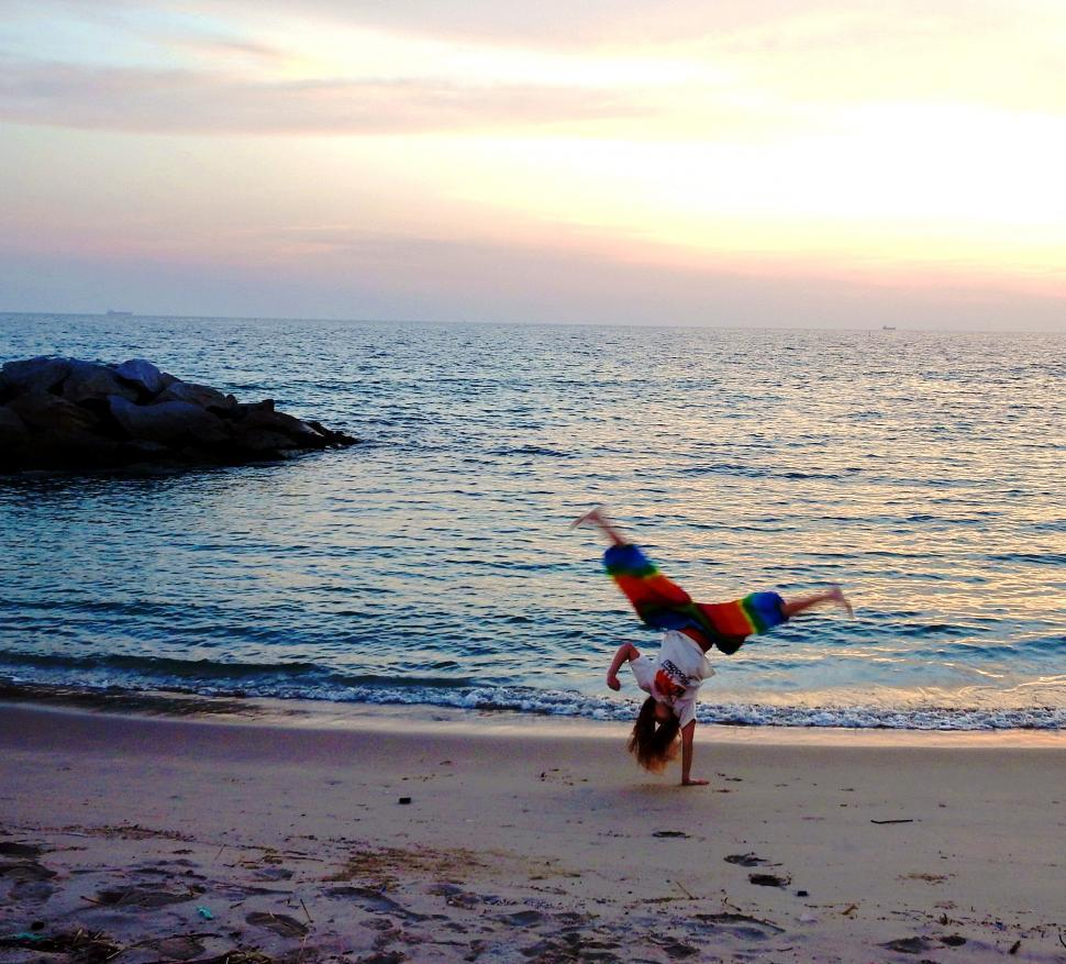 Download Free Stock HD Photo of Girl does Handstand on the Beach   Online