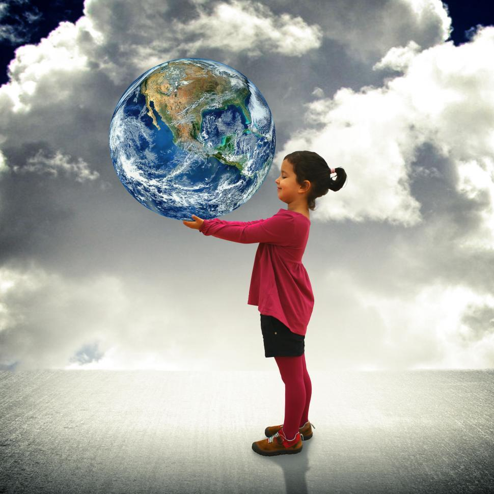 Download Free Stock HD Photo of Child holding the world in her hands Online