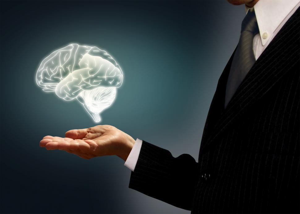 Download Free Stock HD Photo of Businessman holding a virtual brain in the palm - Skills concept Online