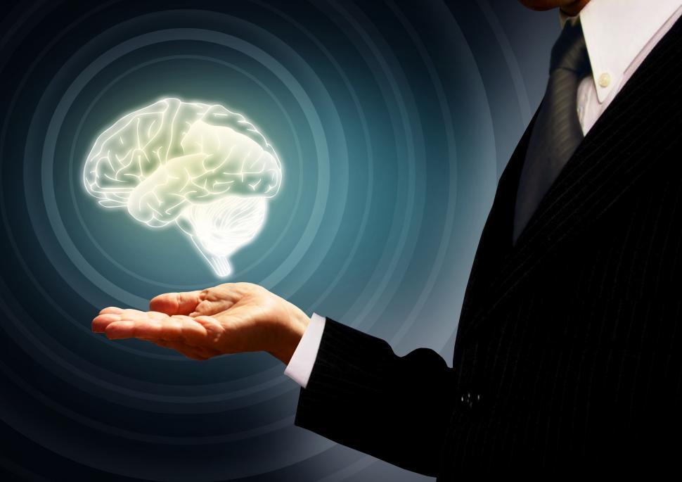 Businessman holding a brain in the palm - Skills concept - Conce
