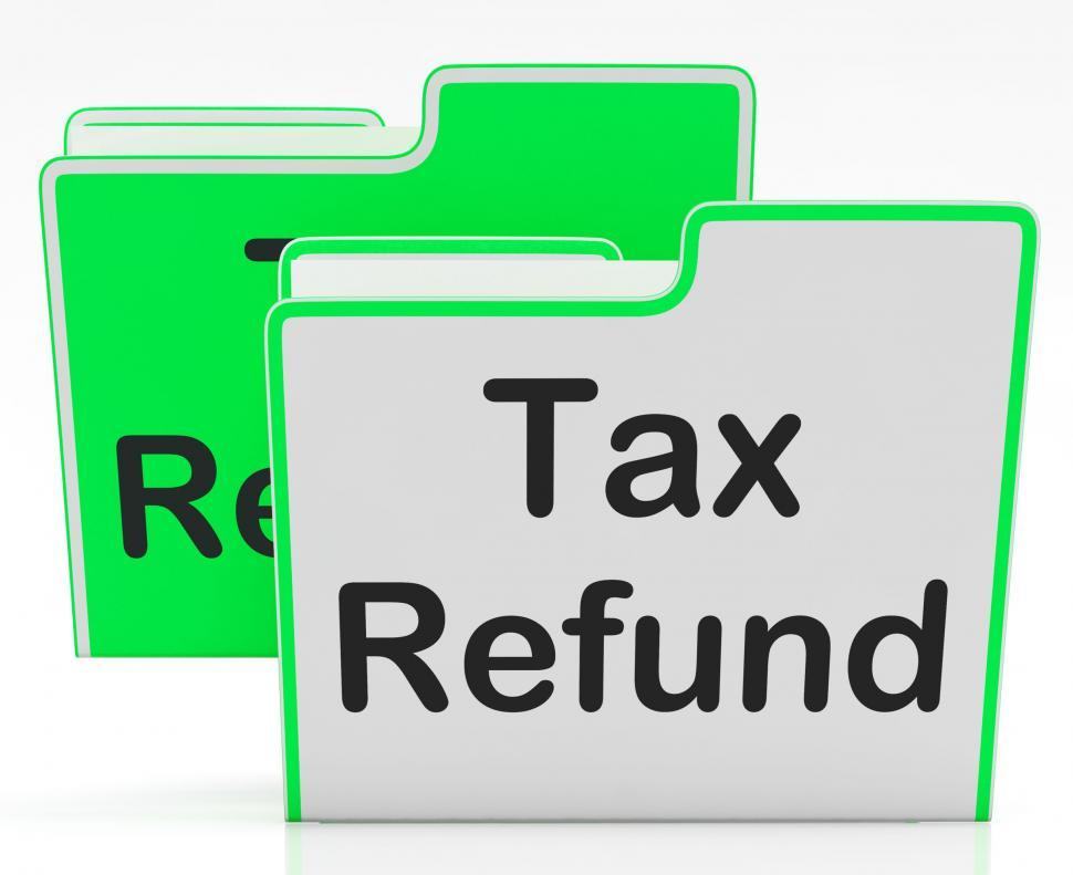 Download Free Stock HD Photo of Tax Refund Indicates Taxes Paid And Binder Online